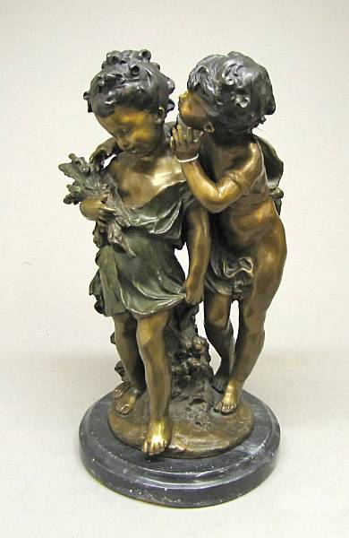 A patinated bronze figural group of two children