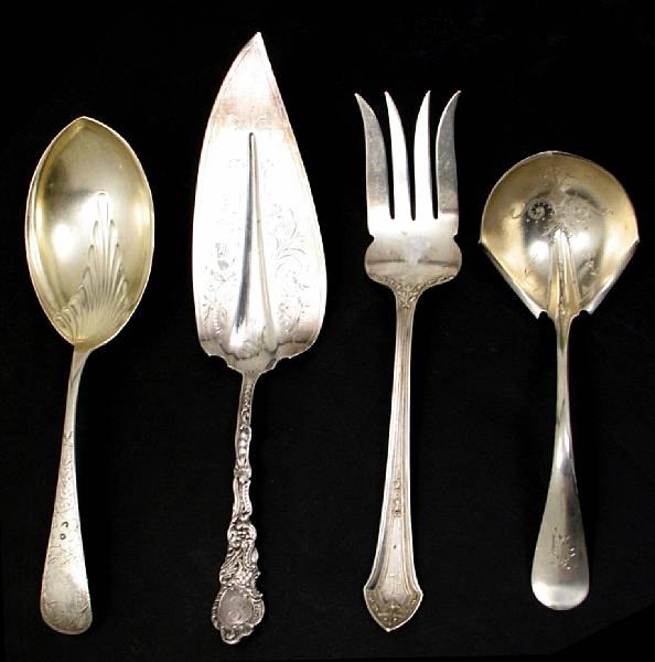 A group of sterling serving pieces