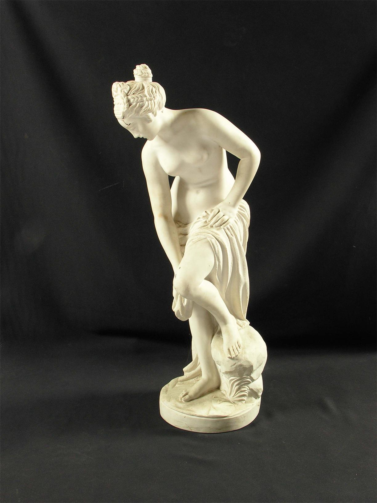 A carved marble figure of the bathing Venus