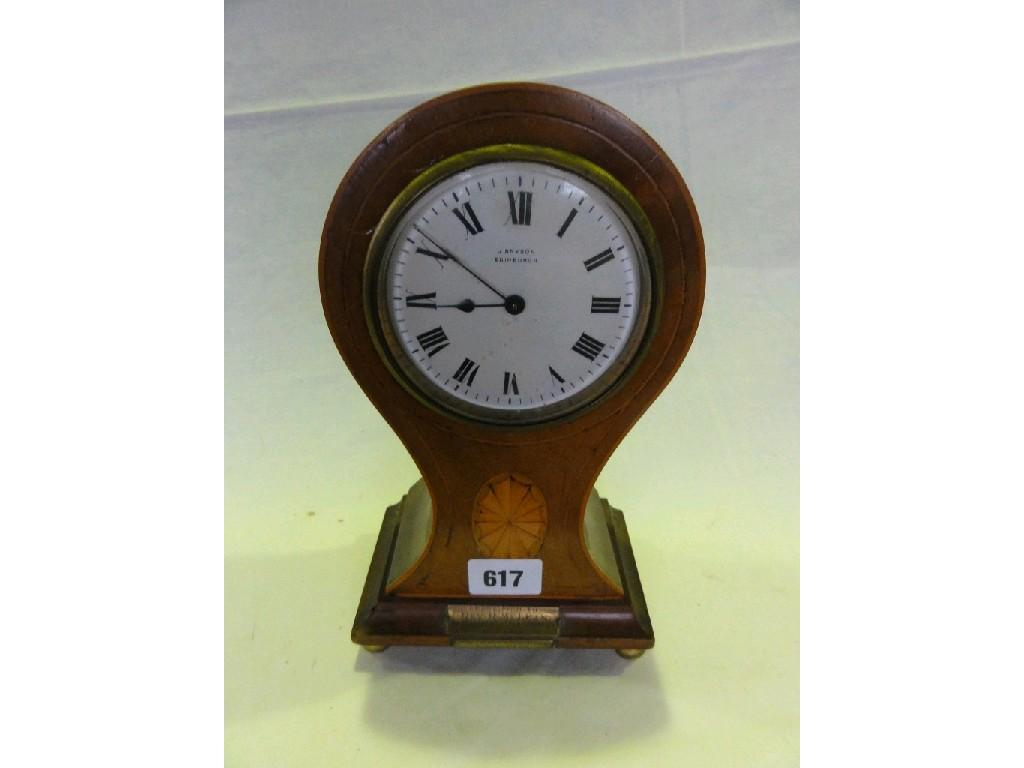 An Edwardian mahogany mantle clock with a