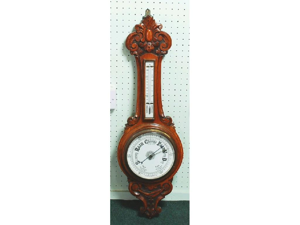 LATE VICTORIAN CARVED OAK ANEROID WHEEL BAROMETER,