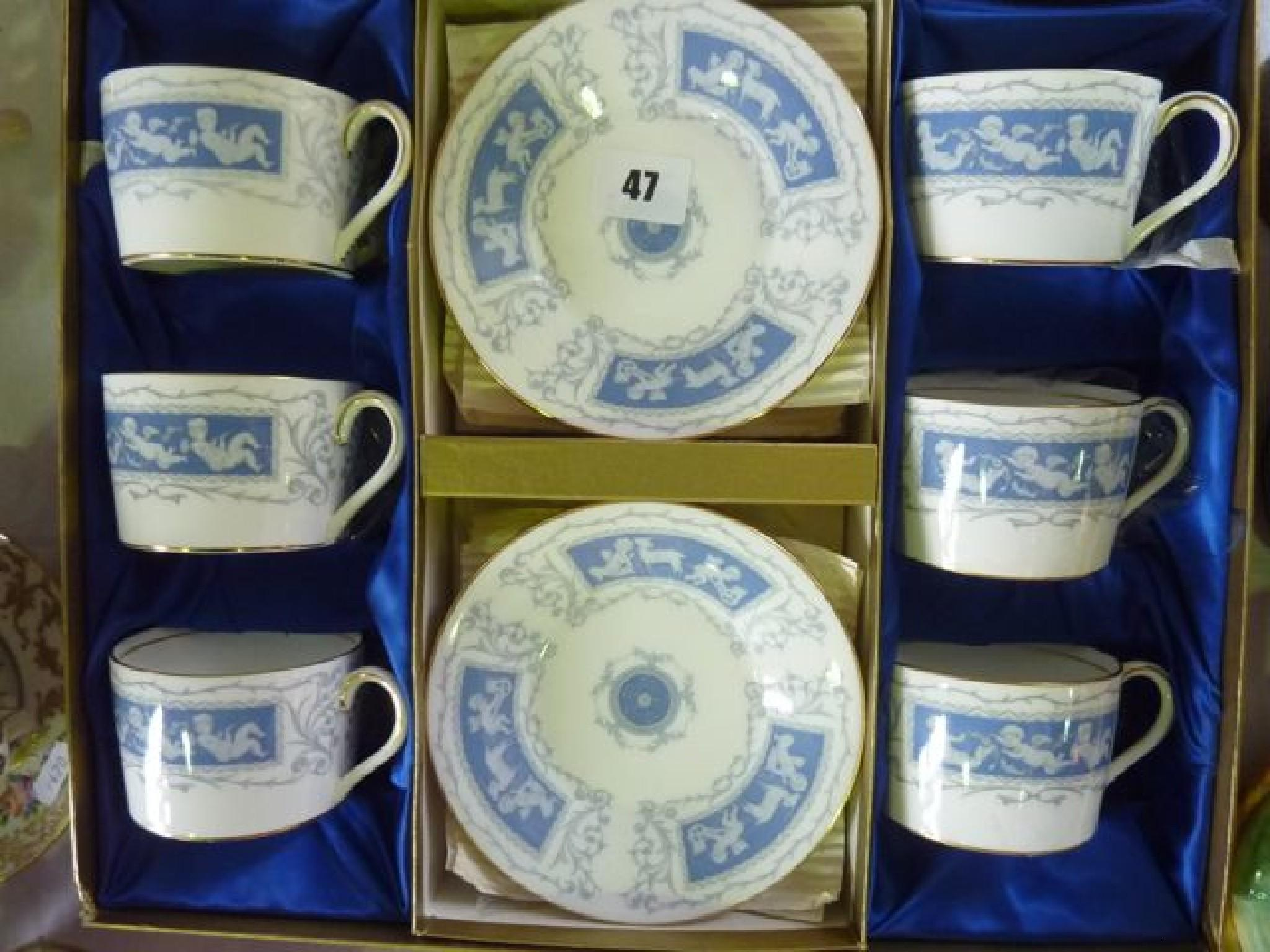 A boxed Coalport 'Revelry' tea set for six