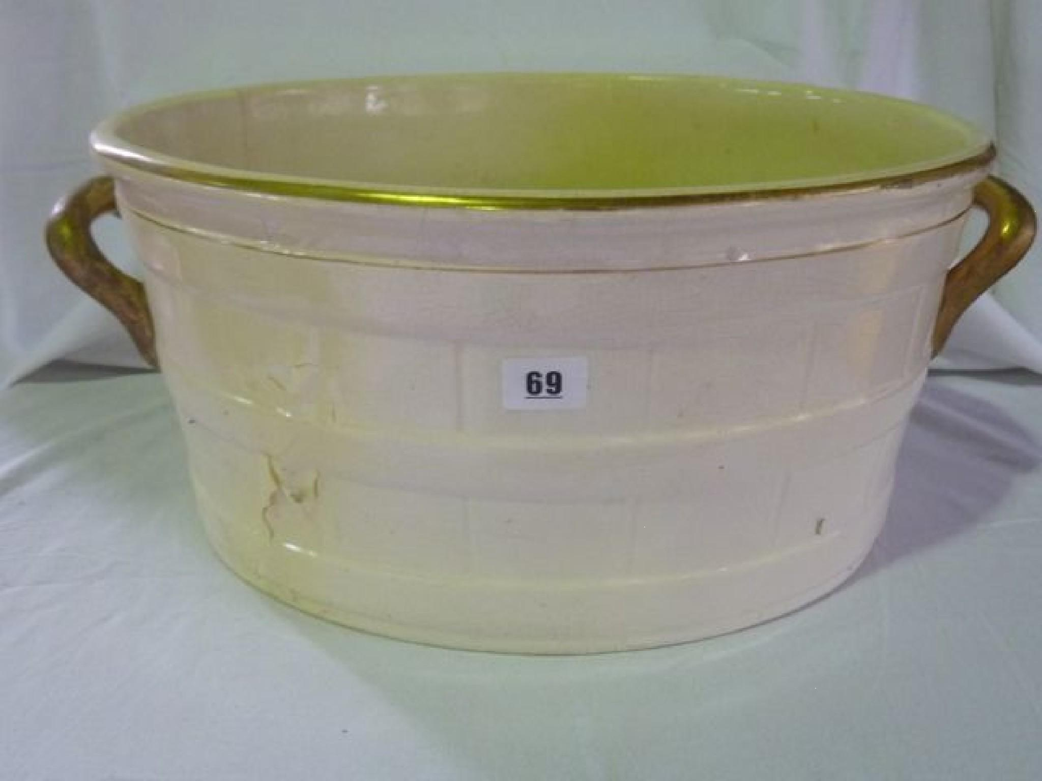 A Victorian footbath in cream with gilded