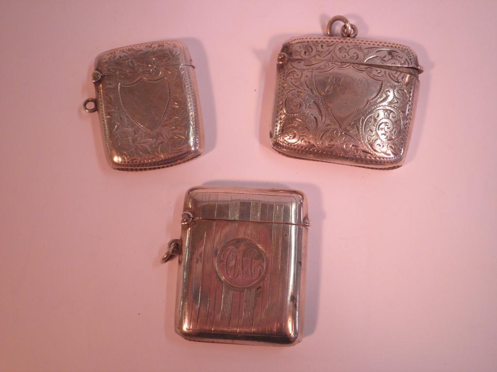 Three Victorian silver vesta cases, one engraved