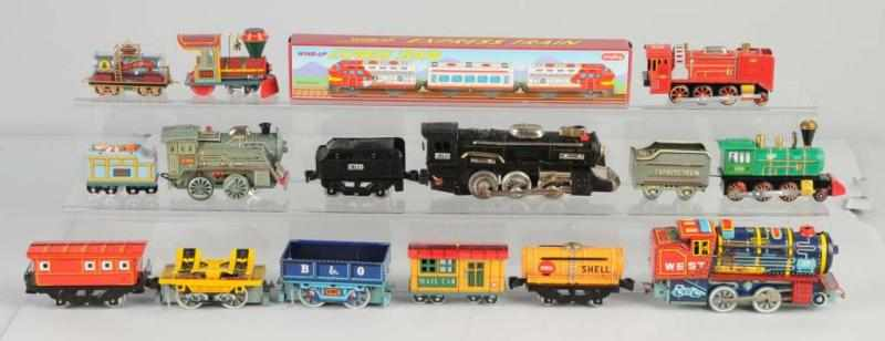 Lot of 19: Tin Litho Train Toys. 