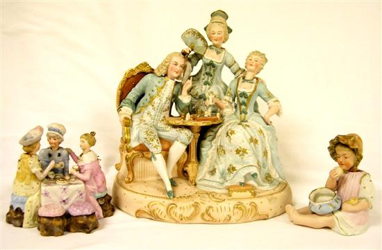 Two bisque porcelain nodder figural groupings