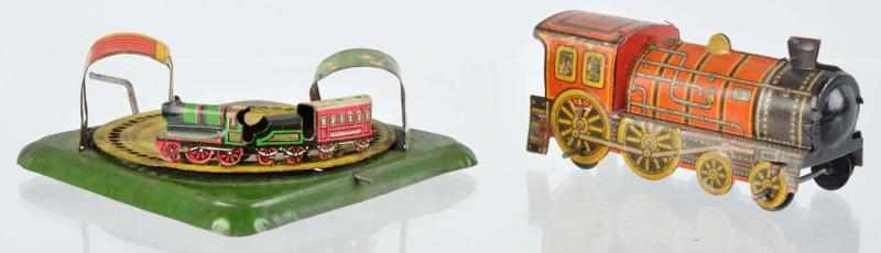 Lot of 2: Tin Litho Train Penny Toys. 
