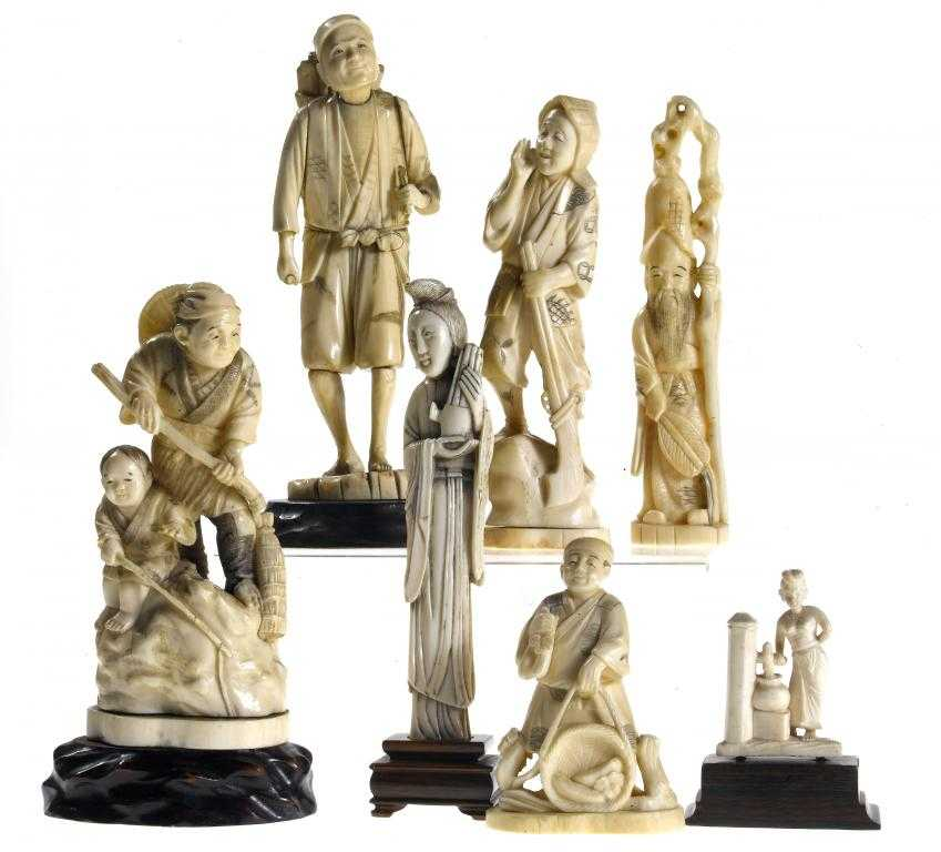 AN IVORY GROUP OF A FISHERMAN AND HIS SON,