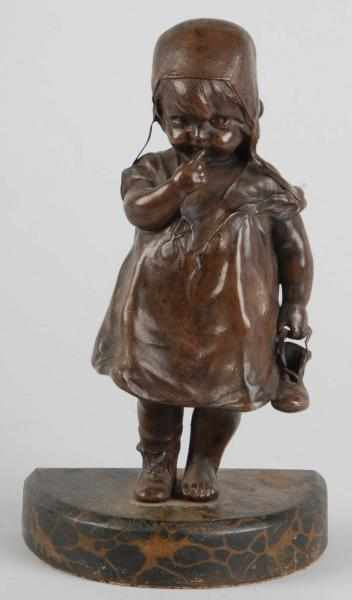 Cast Iron Child Holding Shoe Doorstop. 