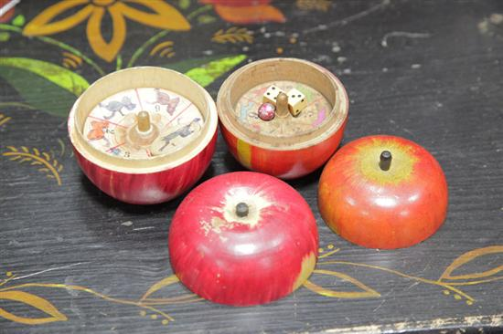 TWO TURNED AND PAINTED WOOD APPLE GAME BOXES.