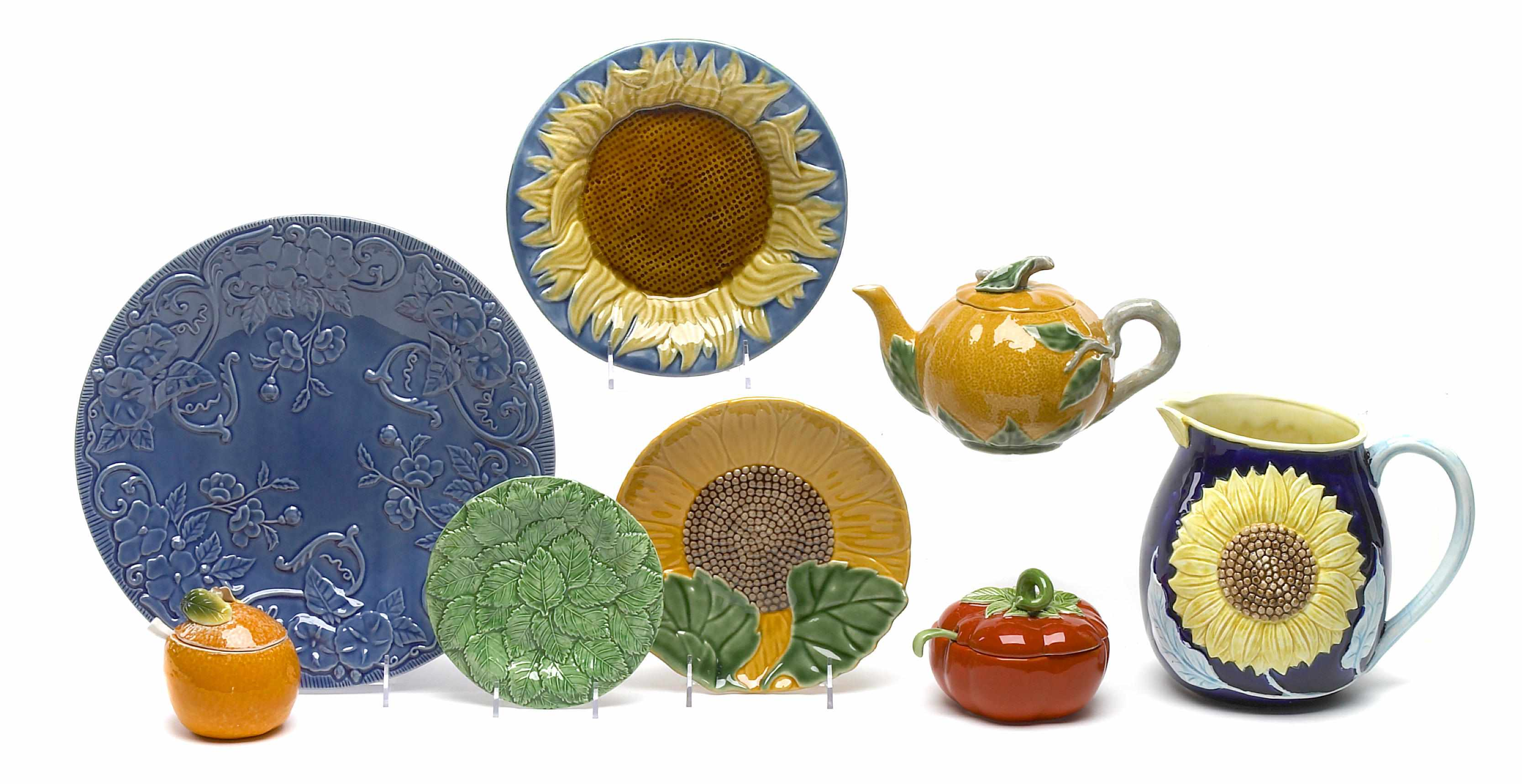 An assortment of paint decorated and glazed