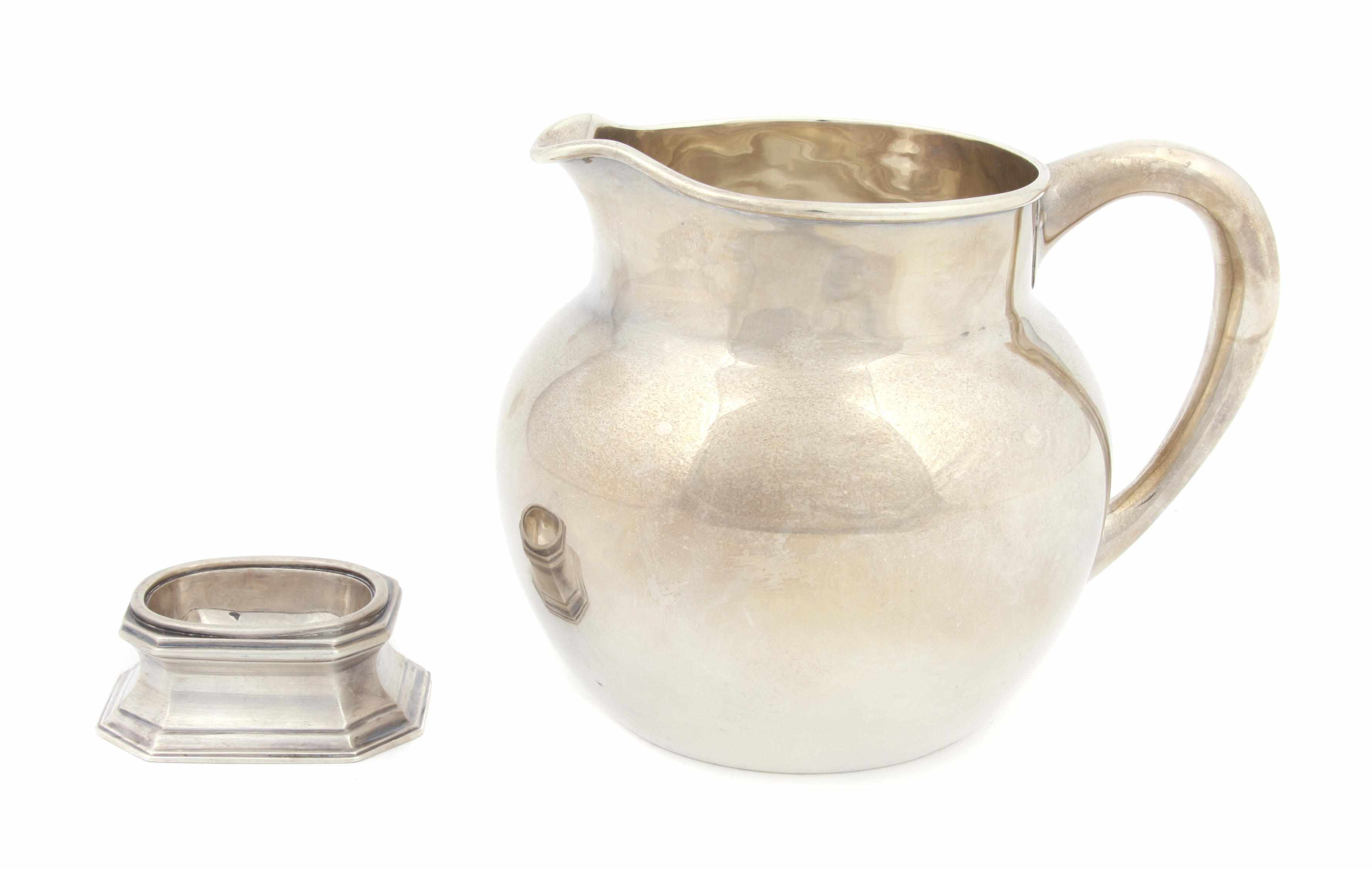 A Victorian sterling silver pitcher Charles