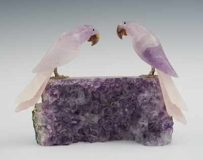 An Amethyst Geode with Two Carved Parrots