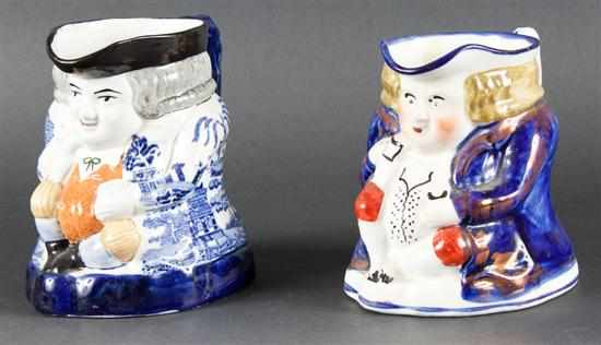 Two Staffordshire painted earthenware toby