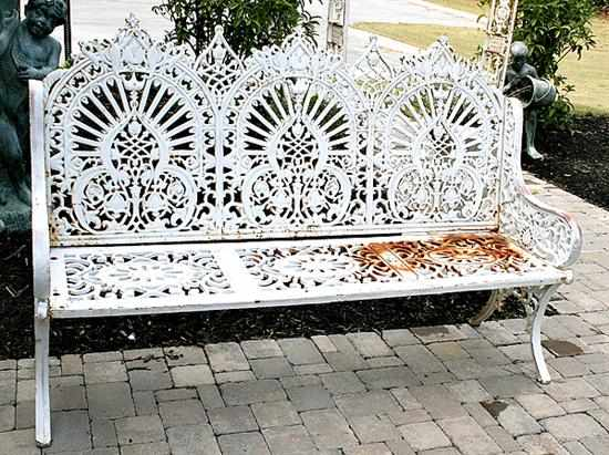 Painted cast-iron garden bench back composed