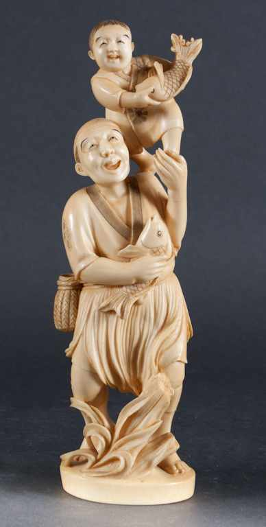 Japanese carved ivory figure of a fisherman