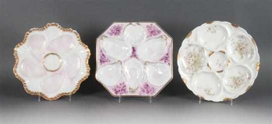 Two German porcelain oyster plates and a