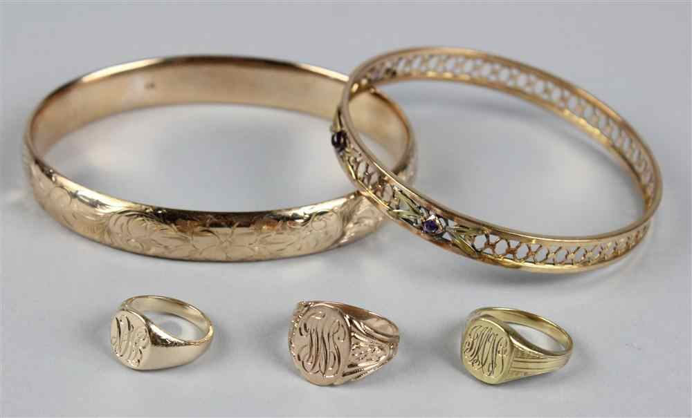 THREE SMALL GOLD SIGNET RINGS AND TWO BANGLE
