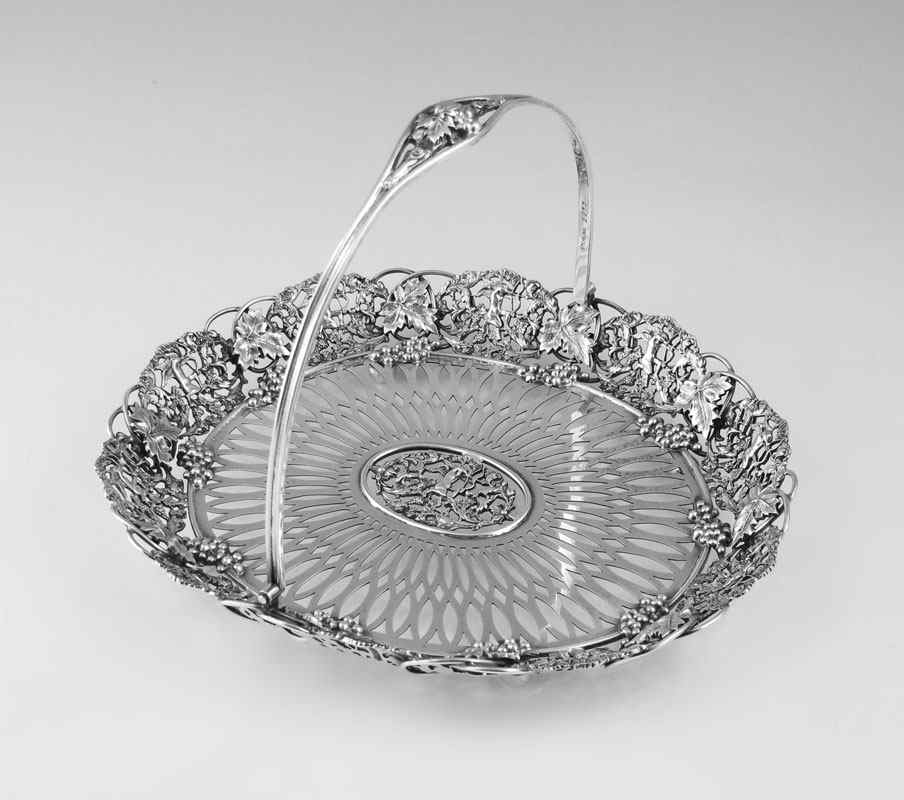 THEODORE STARR REPOUSSE CUPID STERLING BASKET: