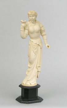 316. A Carved Ivory Figural of a Lady Holding