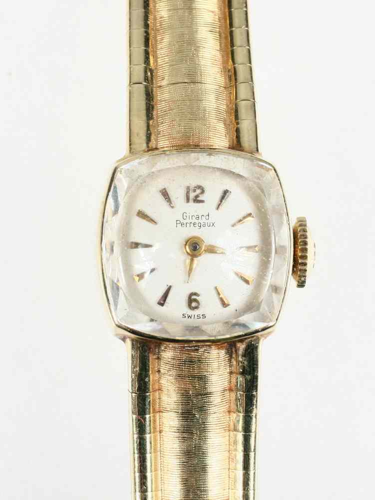 LADY'S WRISTWATCH - One 14K yellow gold Girard