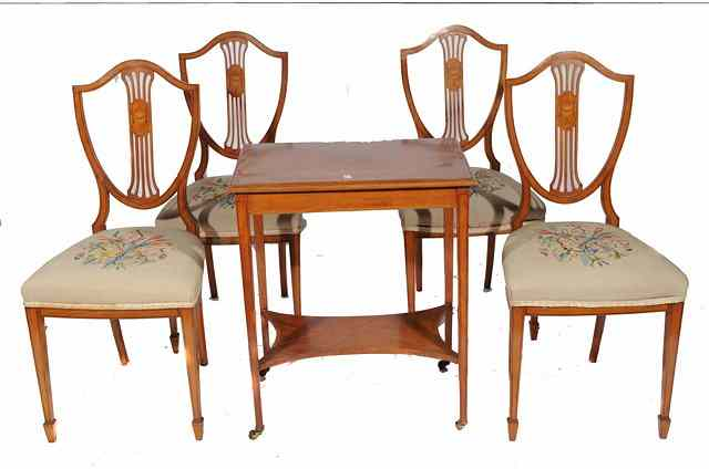 A SET OF FOUR SATINWOOD SHIELD BACK DINING