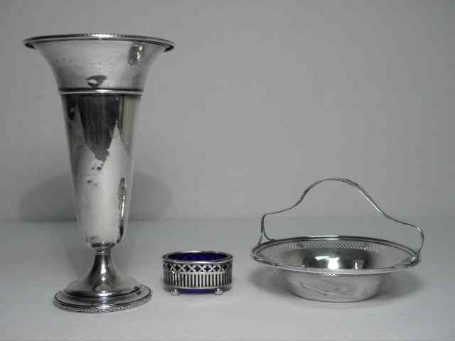 Lot of three assorted sterling silver items.