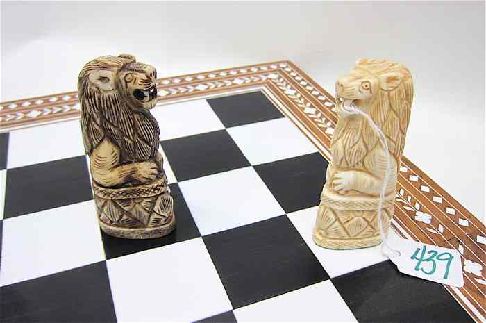 HAND CARVED BONE CHESS SET WITH BOARD one