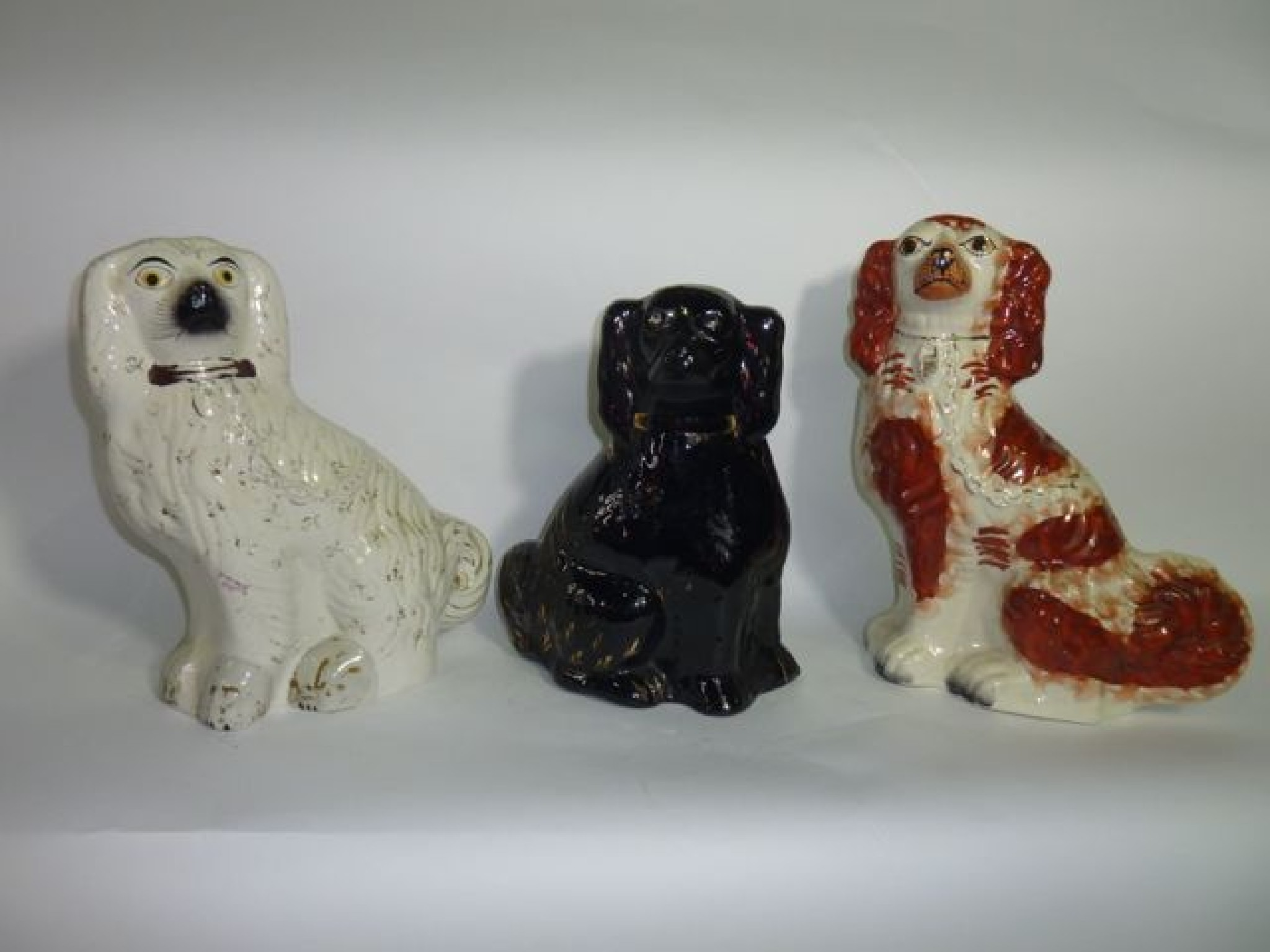 Two 19th century Staffordshire spaniels,