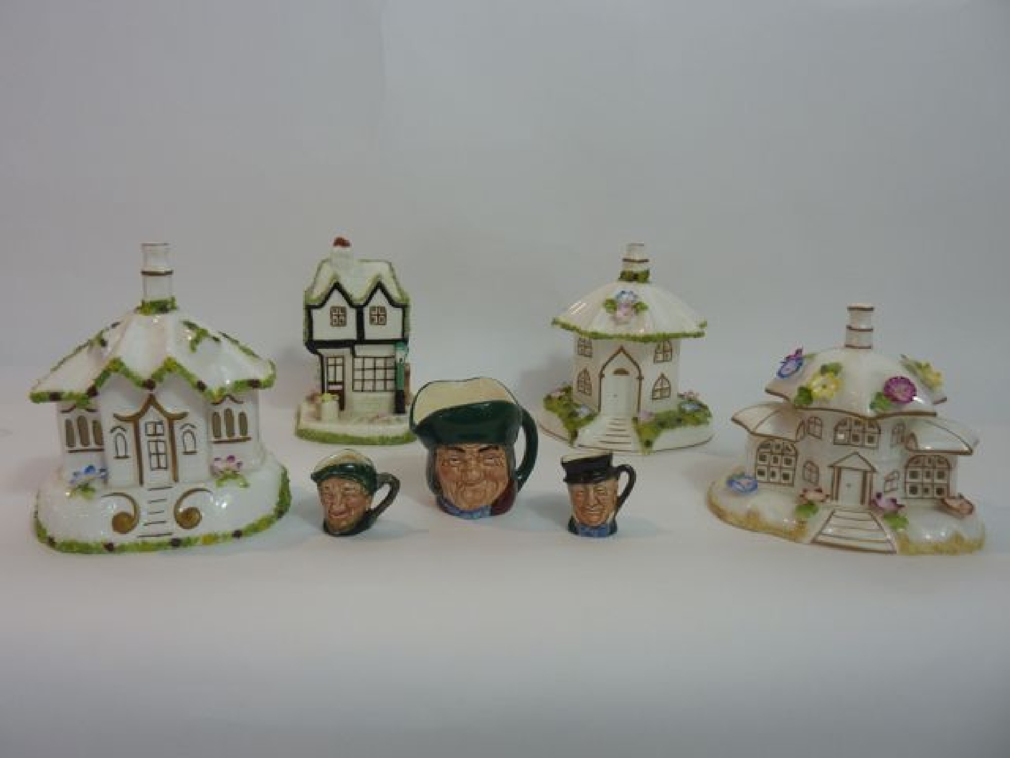 A collection of four Coalport model cottages,