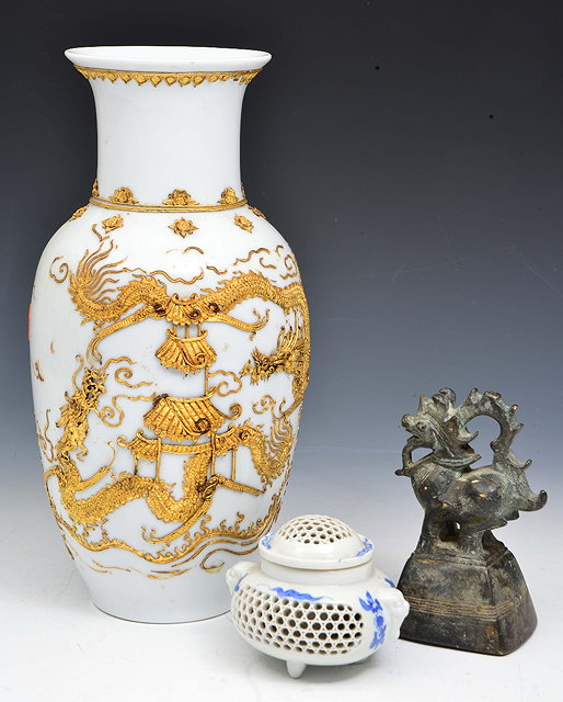 A CHINESE WHITE GROUND PORCELAIN BALUSTER