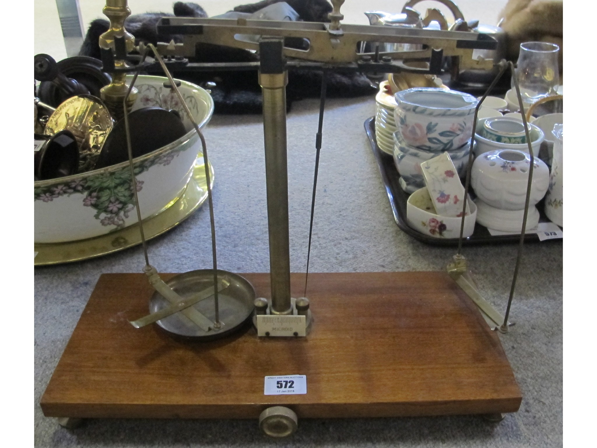 Pair of brass scales on wooden base