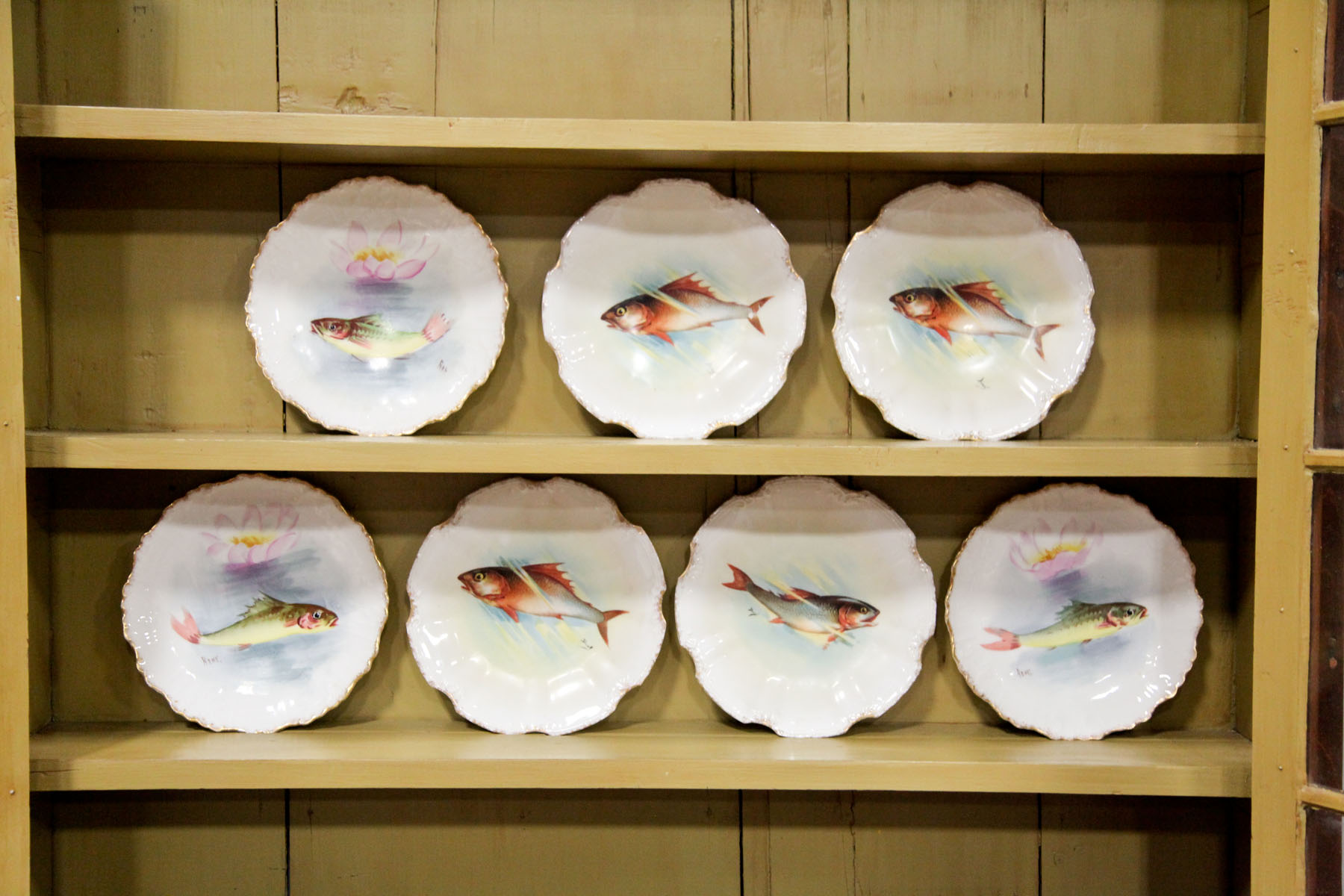 SEVEN LIMOGES FISH PLATES.  France, early