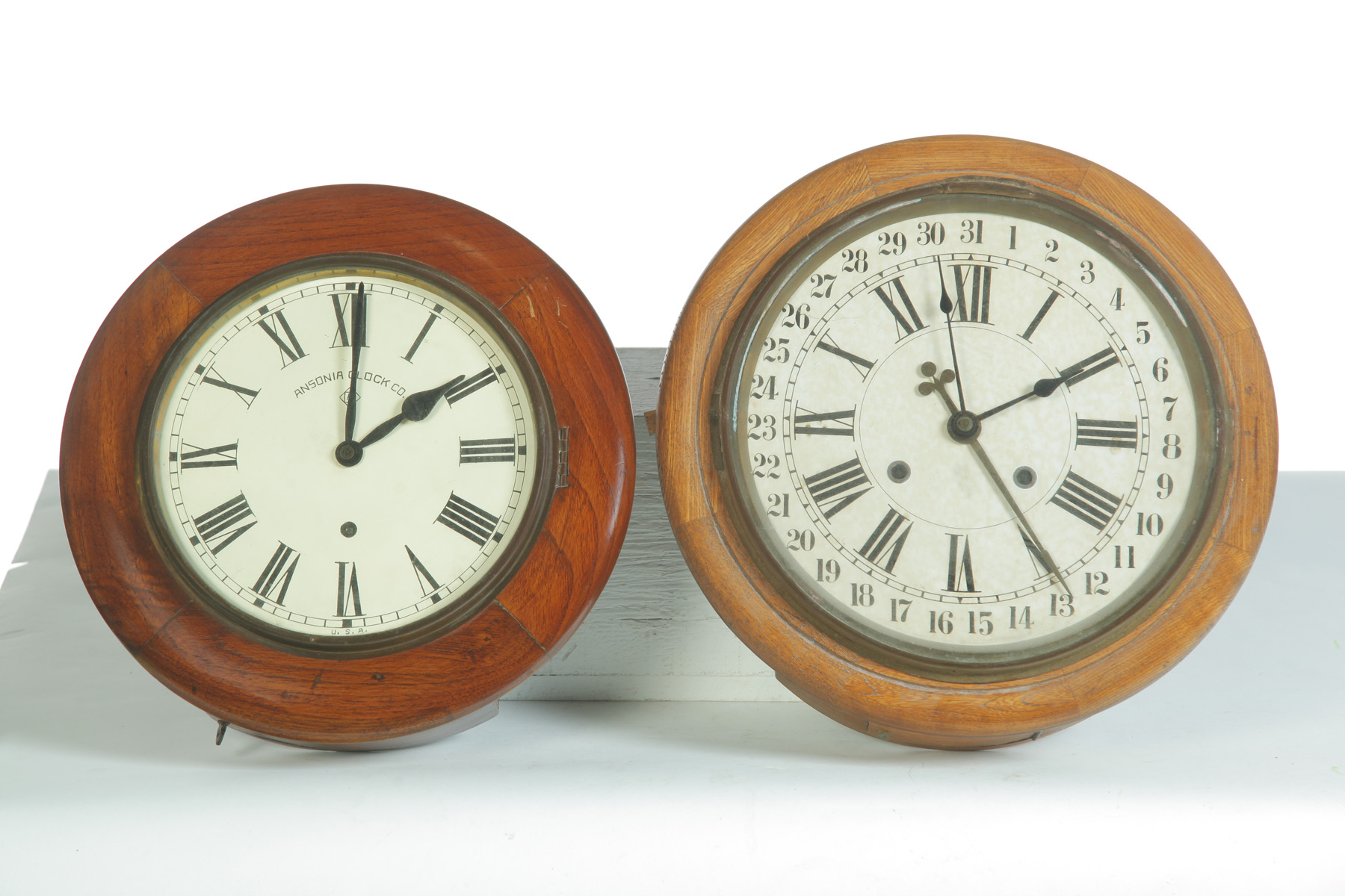 TWO ROUND HANGING WALL CLOCKS.  American,