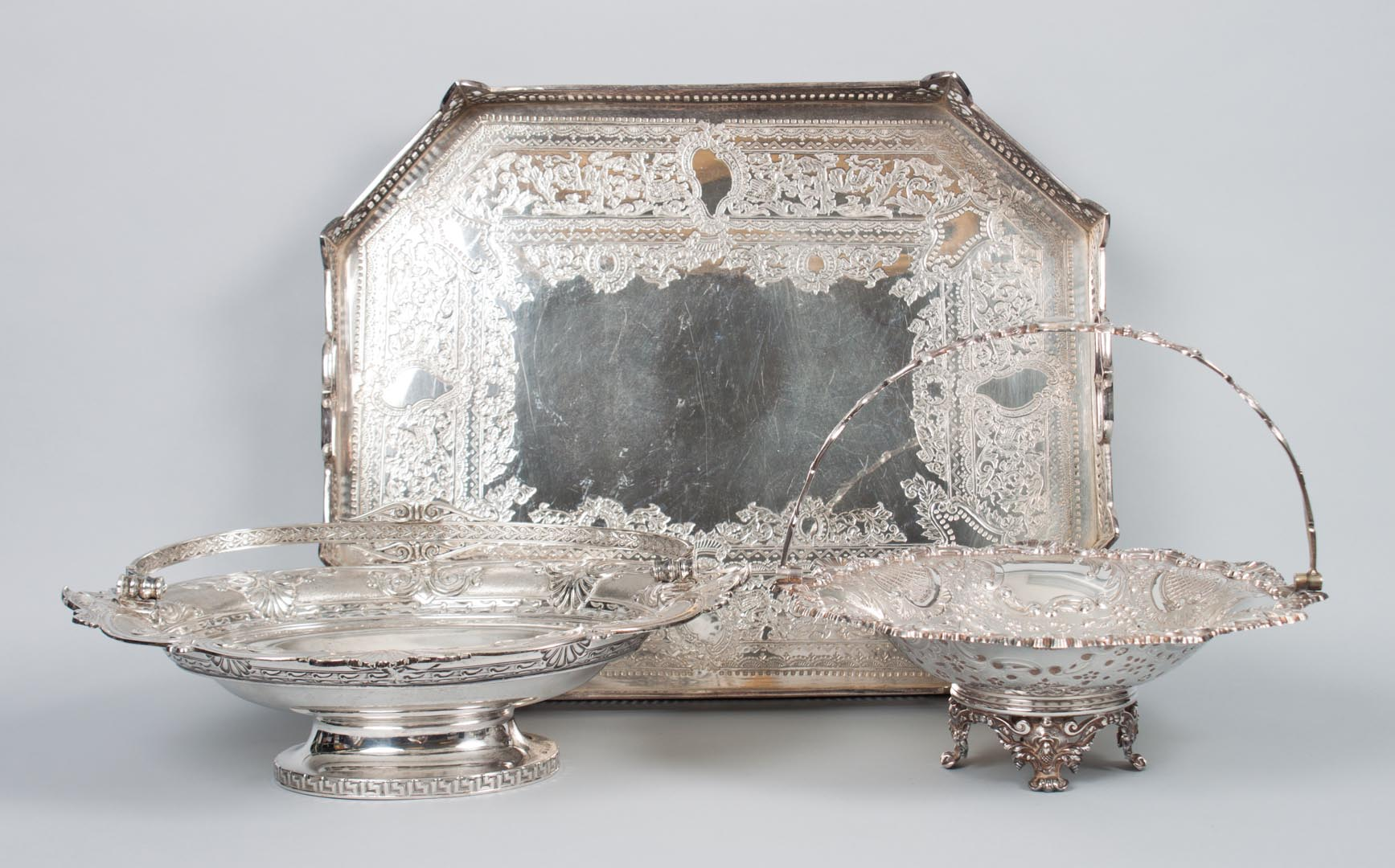 Two silver-plated baskets and a gallery tray