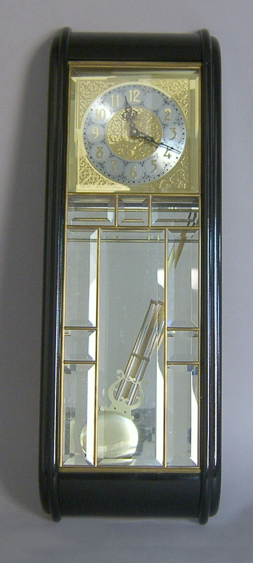 "Ansonia ebonized wall clock, 30 3/4""."