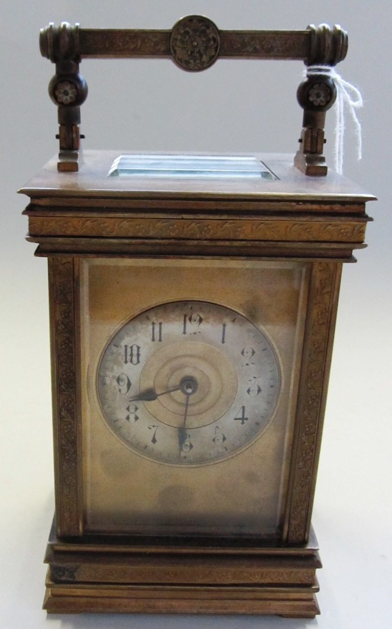 A Victorian brass cased carriage clock, with