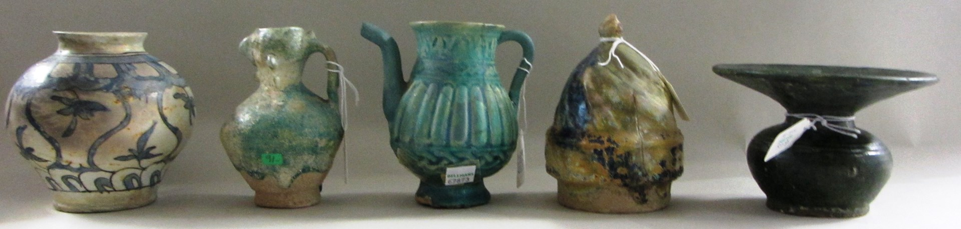 A collection of nine pottery vessels, mostly