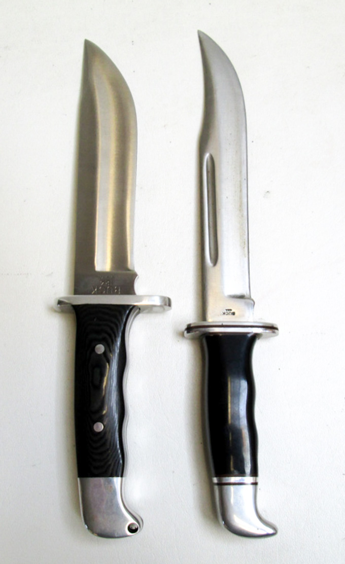 Price guide for TWO COLLECTABLE BUCK FIXED BLADE KNIVES,