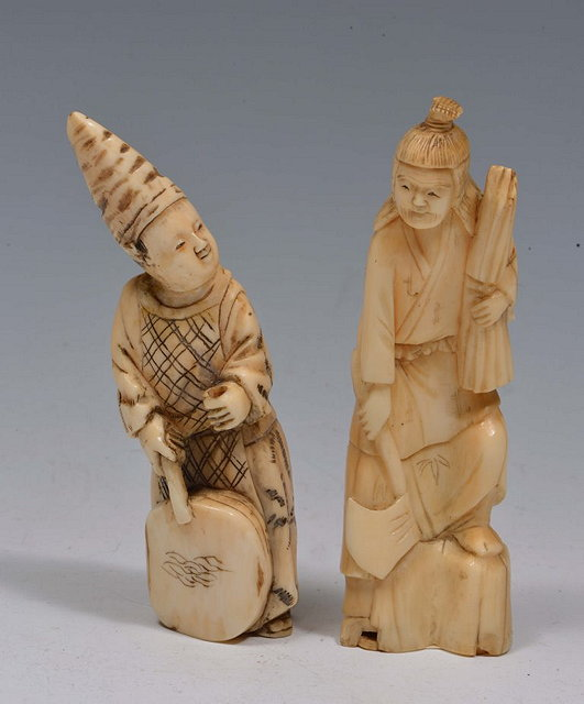 A JAPANESE CARVED IVORY OKIMONO in the form