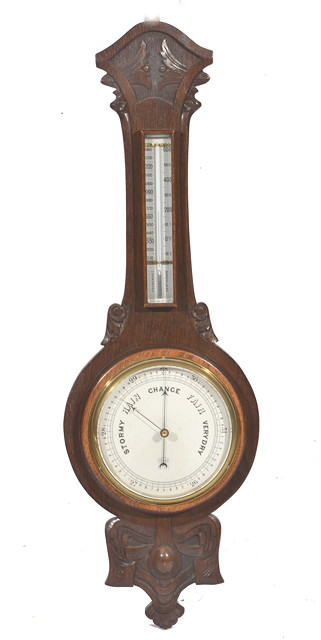 AN EARLY 20TH CENTURY ANEROID WHEEL BAROMETER,