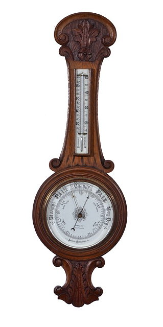 AN OAK ANEROID WHEEL BAROMETER, the 7 1/2""