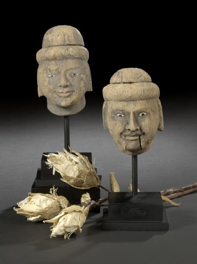 Pair of Indian Carved Heads of Servants,