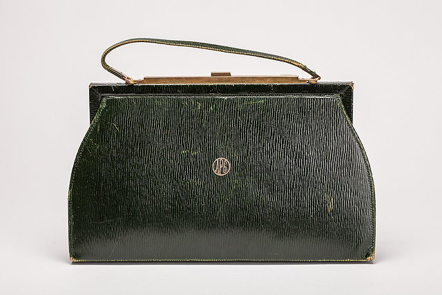 A 1920s green leather Asprey handbag with