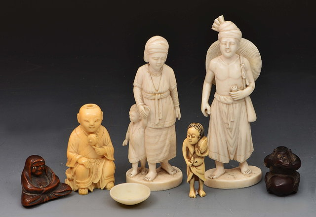 Pair of Burmese carved ivory figuresa Japanese