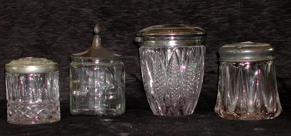 Group of Four Glass Jars with Silver Lids,