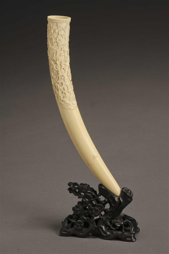 Chinese Ivory Tusk on a Hardwood Stand First