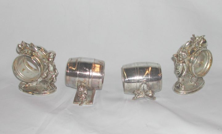 Group of Four Napkin Rings,  consisting of