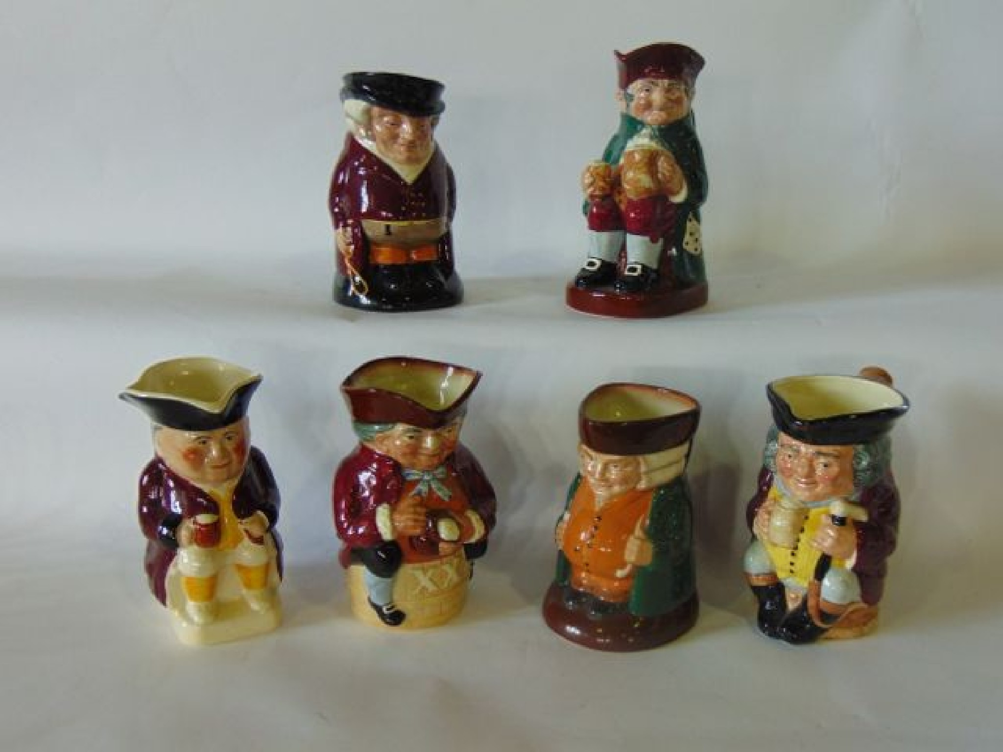A collection of five Royal Doulton Toby Jugs