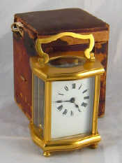 A gilt brass clock in original travelling